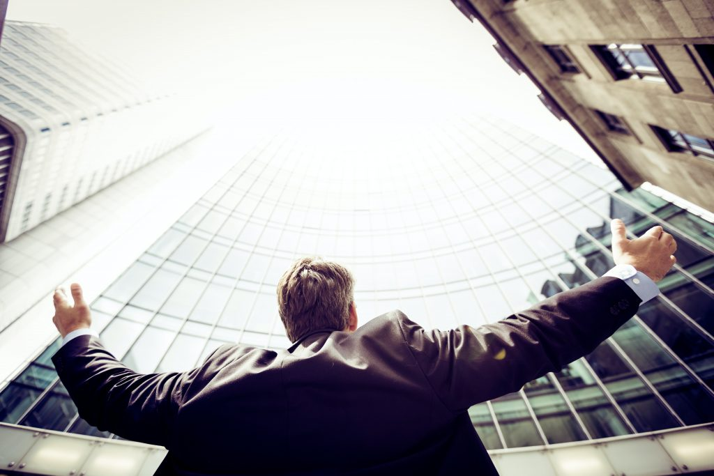 Man holding his hands up in the air and used as a descriptive image for podcast episode: Career mastery and career security with 'Me Ltd'.