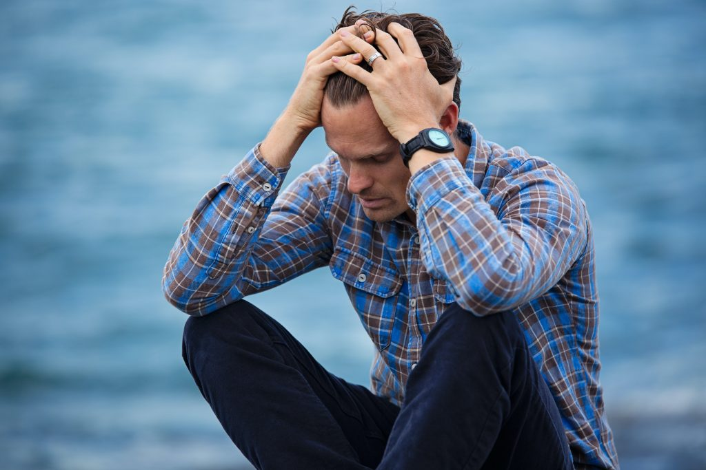 Unhappy Man. Blog on how negative self-talk is holding you back in your career